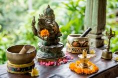 resort - small ganesha displays, singing bowls and many more can be found in the yoga shala, room and other areas in the Kumara Sakti resort - copyright Oneworld Retreats