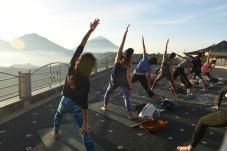 yoga - energising sunrise yoga overlooking Batur Volcano - copyright Oneworld Retreats